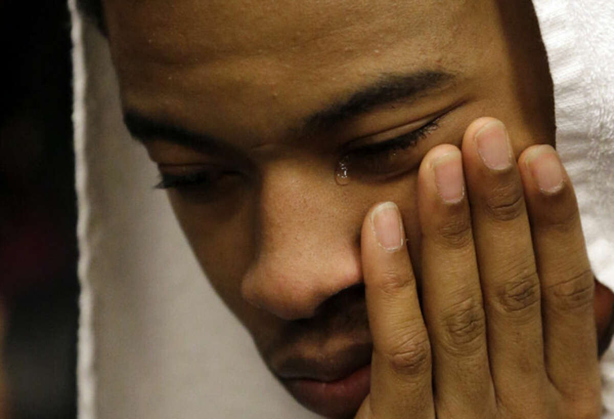 Kentucky's Tyler Ulis cries as he sits in the locker after the NCAA Final Four tournament college basketball semifinal game against Wisconsin Saturday, April 4, 2015, in Indianapolis. Wisconsin won 71-64. (AP Photo/David J. Phillip)