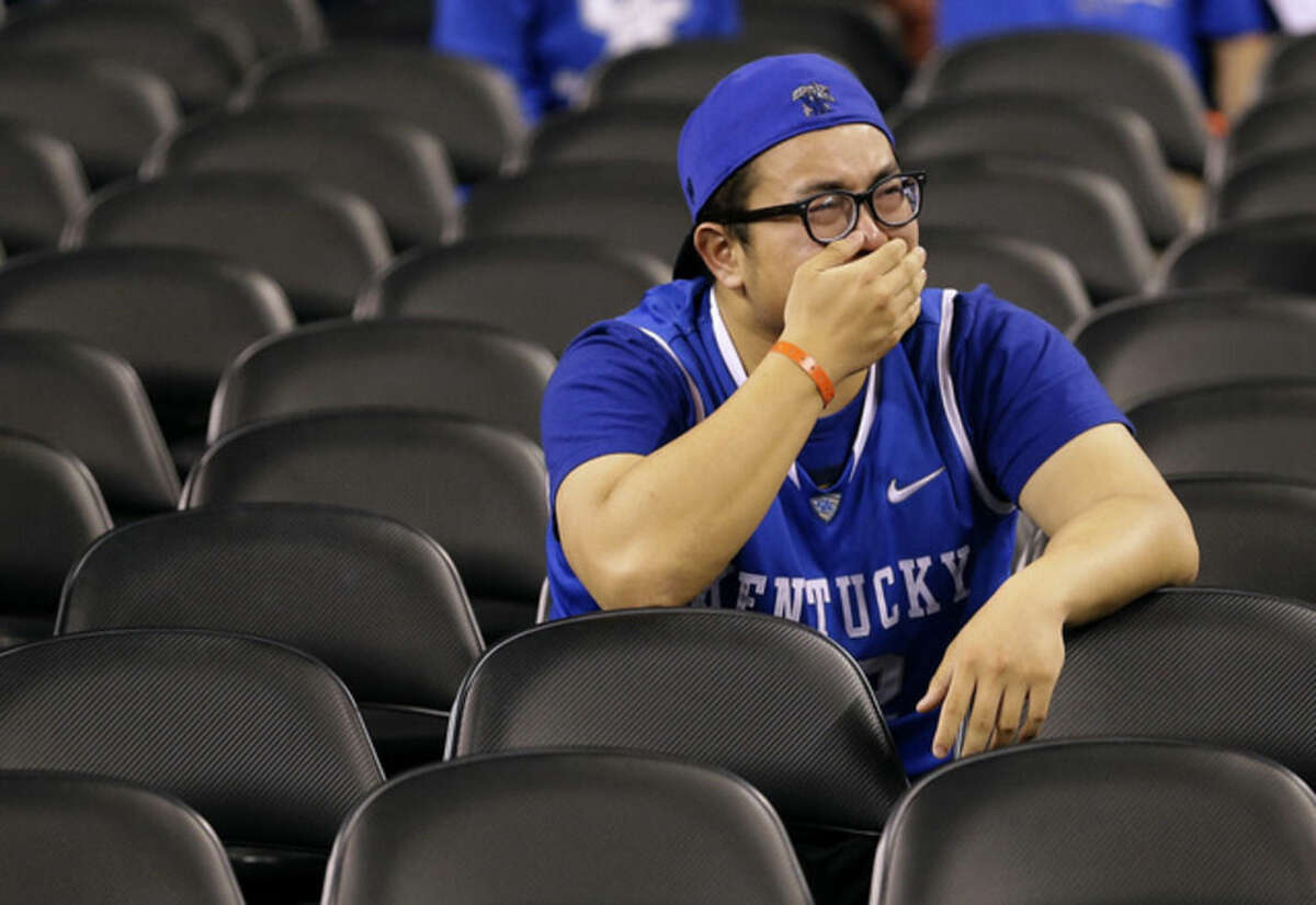 A Kentucky reacts in the stands after an NCAA Final Four tournament college basketball semifinal game between Wisconsin and Kentucky Saturday, April 4, 2015, in Indianapolis. Wisconsin won 71-64. (AP Photo/David J. Phillip)