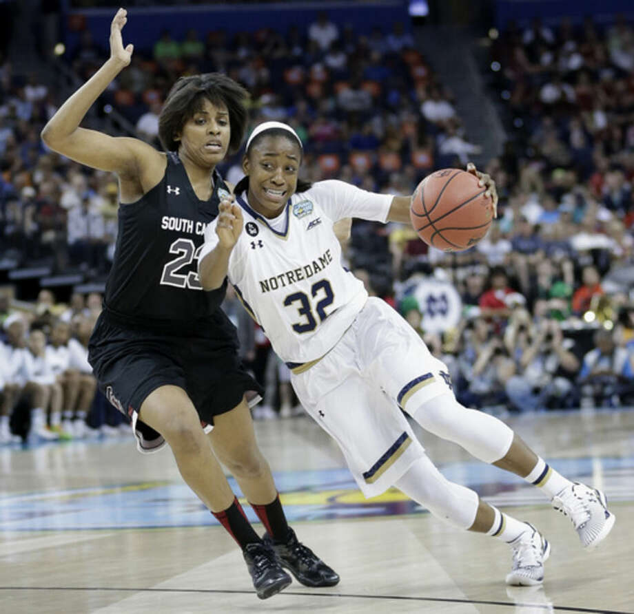 Notre Dame guard Jewell Loyd (32) moves by South Carolina guard Tina Roy (23) during the first half of the NCAA Women's Final Four tournament college basketball semifinal game, Sunday, April 5, 2015, in Tampa, Fla. (AP Photo/John Raoux)