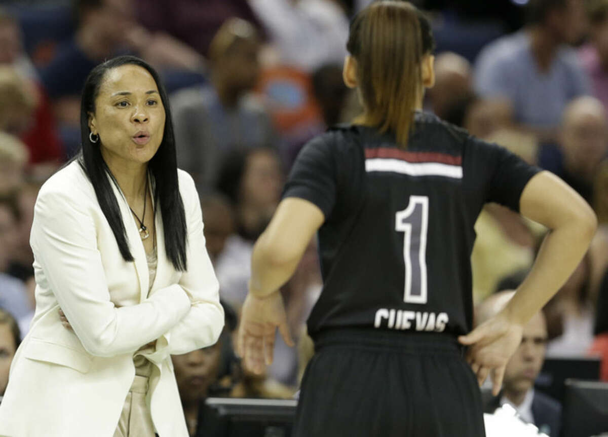South Carolina head coach Dawn Staley speaks to South Carolina guard Bianca Cuevas (1) during the first half of the NCAA Women's Final Four tournament college basketball semifinal game against Notre Dame, Sunday, April 5, 2015, in Tampa, Fla. (AP Photo/John Raoux)