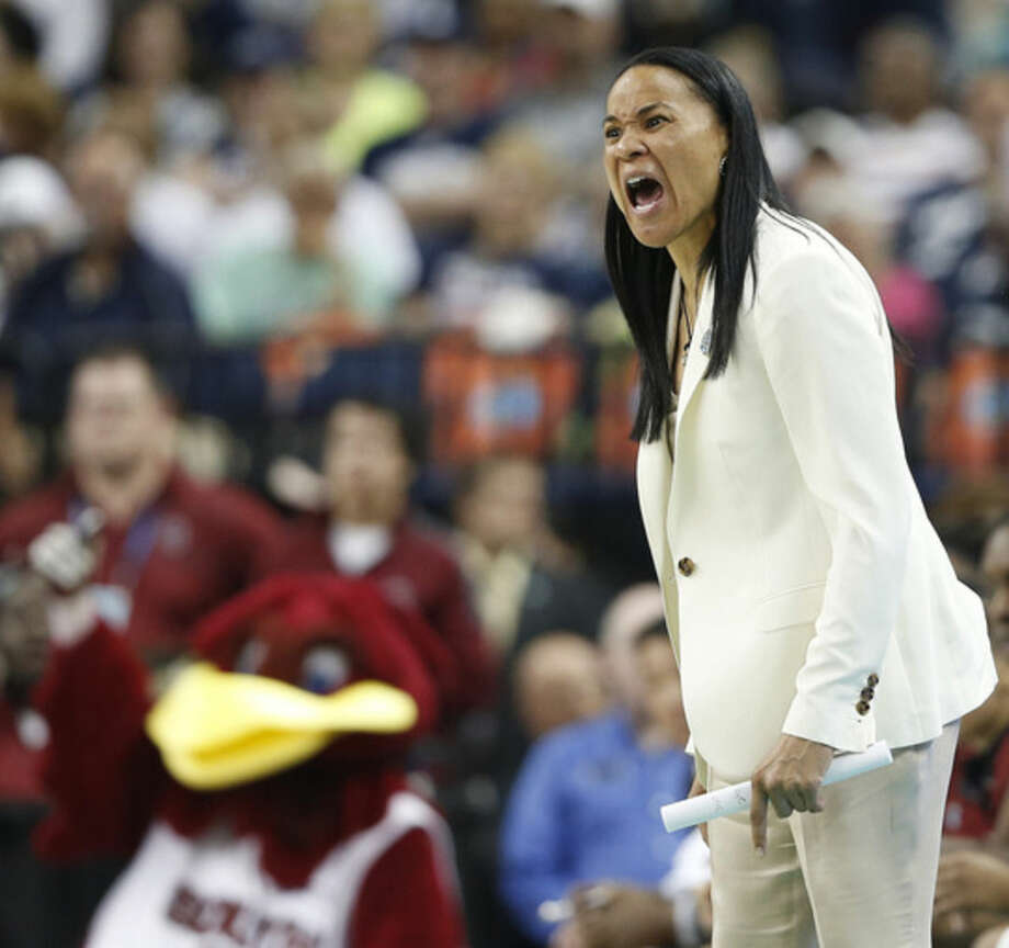 South Carolina head coach Dawn Staley speaks to players during the second half of the NCAA Women's Final Four tournament college basketball semifinal game against Notre Dame, Sunday, April 5, 2015, in Tampa, Fla. (AP Photo/Brynn Anderson)