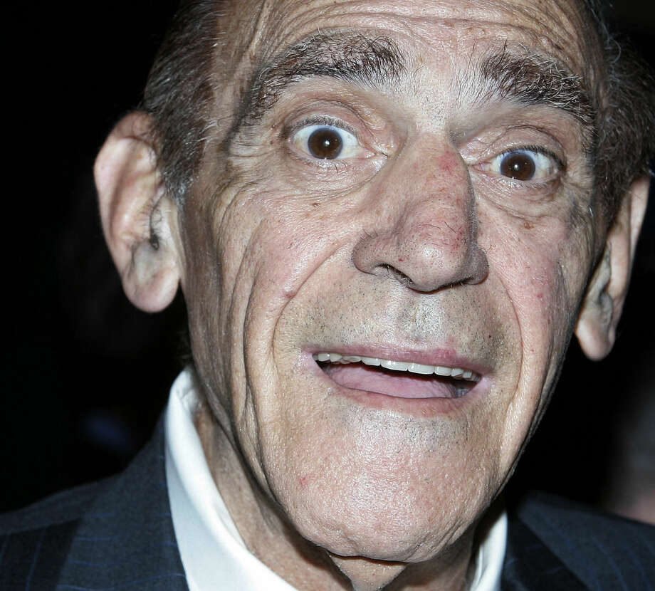 FILE - In a June 9, 2006 file photo, actor-comedian Abe Vigoda attends the Friars Club celebrity roast of legendary comedian Jerry Lewis in New York City. Vigoda, whose leathery, sunken-eyed face made him ideal for playing the over-the-hill detective Phil Fish in the 1970s TV series `Barney Miller' and the doomed Mafia soldier in `The Godfather,' died in his sleep Tuesday, Jan. 26, 2016, at his daughter's home in Woodland Park, N.J. He was 94. (AP Photo/Stephen Chernin, File)