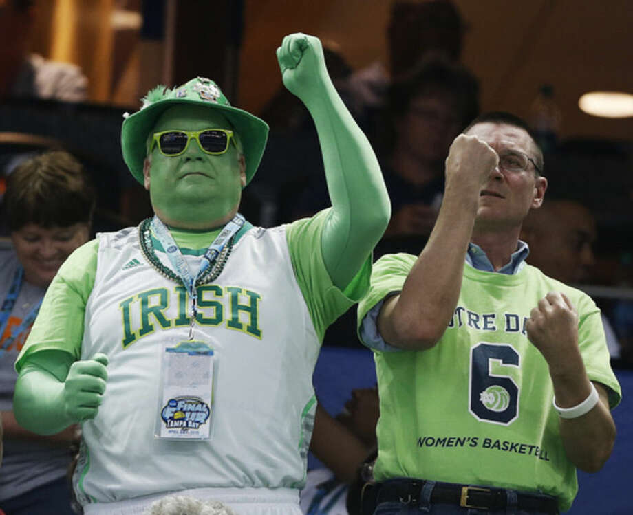 Notre Dame fans watch play against South Carolina during the first half of the NCAA Women's Final Four tournament college basketball semifinal game, Sunday, April 5, 2015, in Tampa, Fla. (AP Photo/Brynn Anderson )