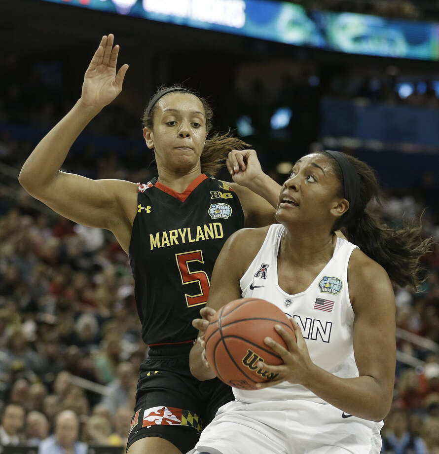 Connecticut forward Morgan Tuck (3) shoots against Maryland center Malina Howard (5) during the first half of the NCAA Women's Final Four tournament college basketball semifinal game, Sunday, April 5, 2015, in Tampa, Fla. (AP Photo/Brynn Anderson )