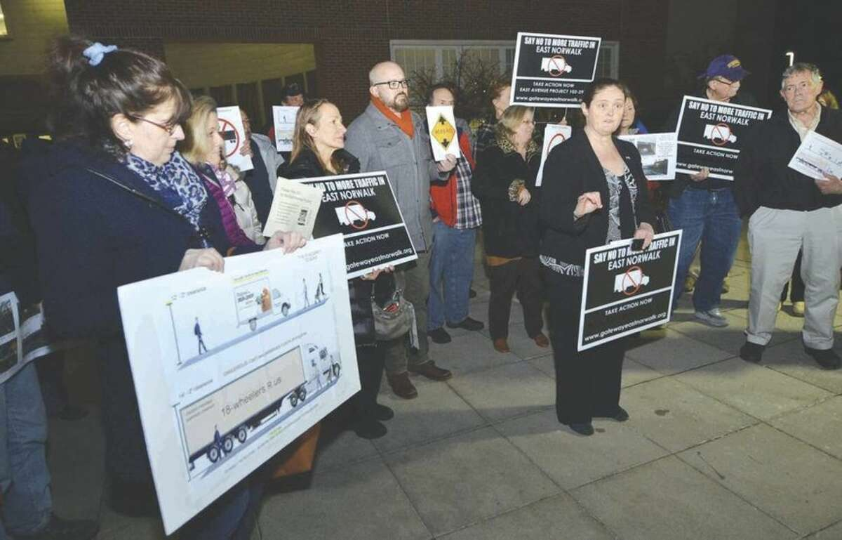 Hour photo/Alex von Kleydorff In front of Norwalk City Hall, Debora Goldstein and other area residents speak their mind and oppose the heightening work proposed to be done on the Metro North Rail bridge over East Avenue.