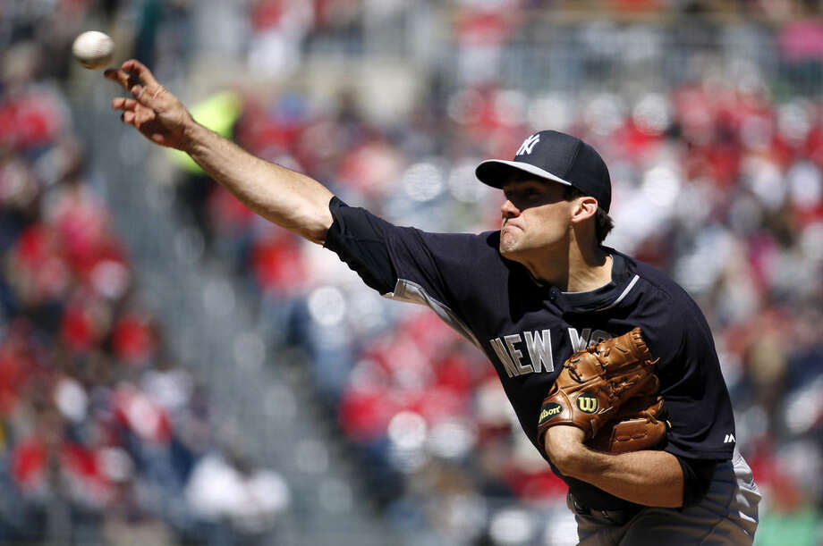 New York Yankees starting pitcher Nathan Eovaldi throws during the second inning of an exhibition baseball game against the Washington Nationals at Nationals Park, Saturday, April 4, 2015, in Washington. (AP Photo/Alex Brandon)