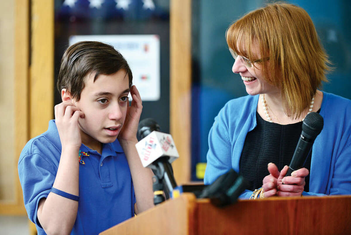 Hour photo / Erik Trautmann Jorden Jallouk gets applause from the crowd after speaking at the Stamford Education 4 Autism World Autism Awareness Day celebration at the Stamford Government Center Wednesday morning.