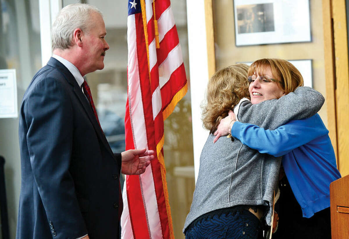 Hour photo / Erik Trautmann Stamford Education 4 Autism president Robin Portanova honors Carol Bryan and Mike Moran of the Palace Theater during the World Autism Awareness Day celebration at the Stamford Government Center Wednesday morning.