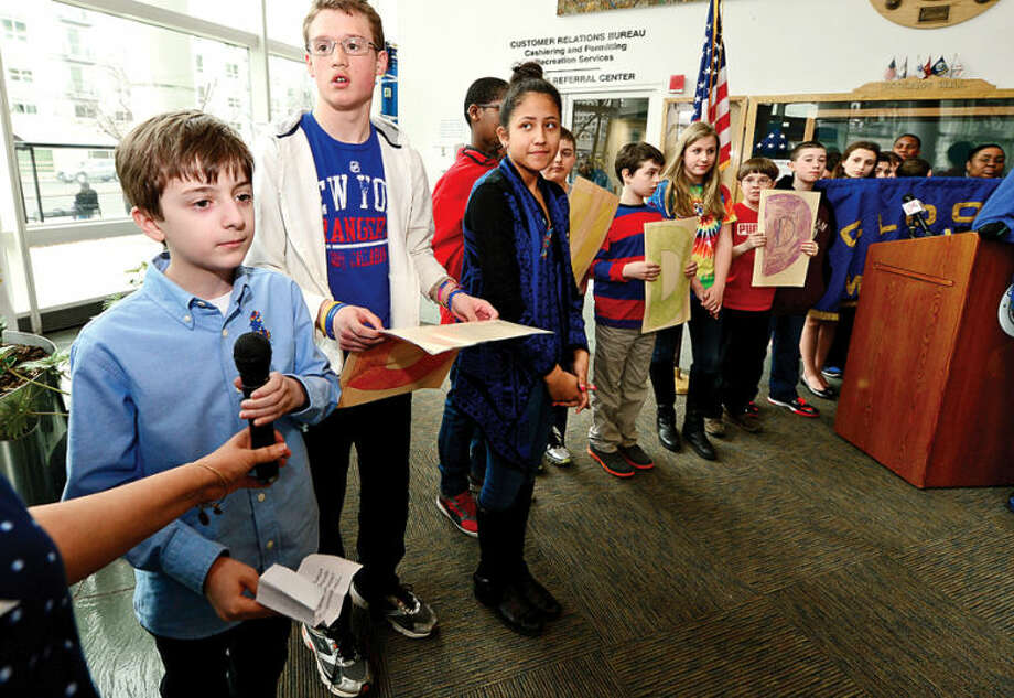 Hour photo / Erik Trautmann Stamford Education 4 Autism buddy Nicholas Portanova speaks at the World Autism Awareness Day celebration at the Stamford Government Center Wednesday morning.