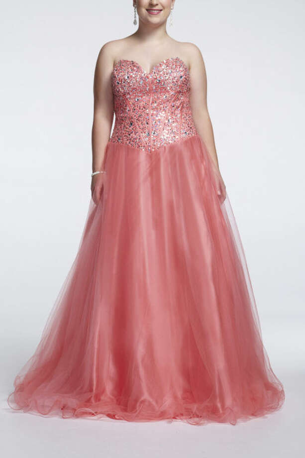 This undated image released by David's Bridal shows a popular prom gown design offered at David's Bridal. Clothes shopping for plus-size teens can be frustrating in general, but shopping for a dream prom dress can be a tear-inducing, hair-pulling morass of bad design and few options _ especially for girls who want a dress that hugs the body instead of tenting it. (AP Photo/David's Bridal)