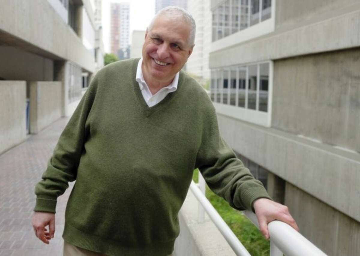 """This Monday, March 24, 2014 photo shows director Errol Morris posing for a photo in Los Angeles. Morris directed the recently released film """"The Unknown Known: The Life and Times of Donald Rumsfeld."""" Morris spent more than 30 hours interviewing Donald Rumsfeld. He sifted through thousands of memos _ ?""""snowflakes,?"""" Rumsfeld called them _ from the former Secretary of Defense and architect of the Iraq War. (AP Photo/Richard Vogel)"""