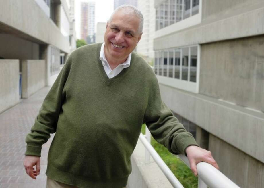"""This Monday, March 24, 2014 photo shows director Errol Morris posing for a photo in Los Angeles. Morris directed the recently released film """"The Unknown Known: The Life and Times of Donald Rumsfeld."""" Morris spent more than 30 hours interviewing Donald Rumsfeld. He sifted through thousands of memos _ """"snowflakes,"""" Rumsfeld called them _ from the former Secretary of Defense and architect of the Iraq War. (AP Photo/Richard Vogel)"""