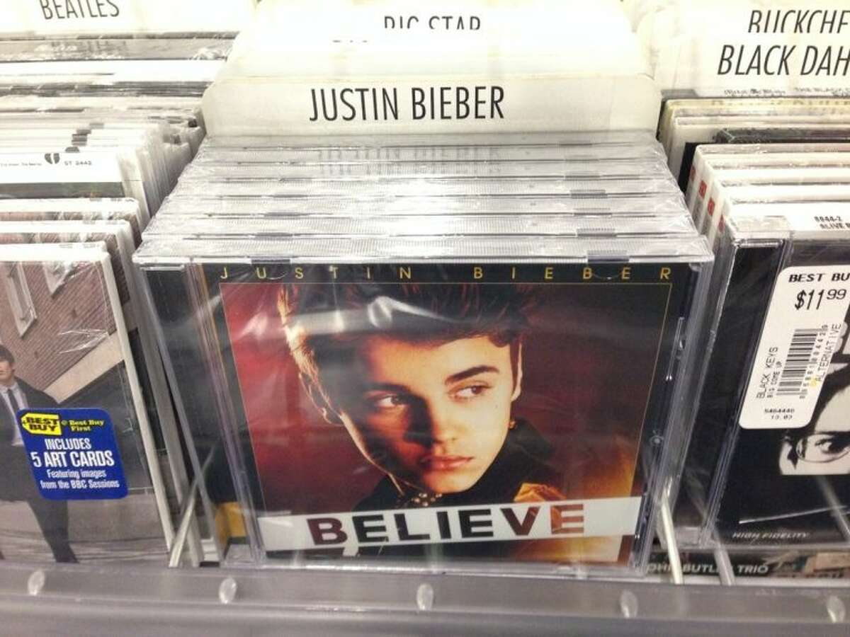"""In this image an album that appears to be Justin Bieber's """"Believe"""" sits on the rack at the Best Buy in Culver City, Calif., Tuesday April 1, 2014. Paz, whose full name is Paz Dylan, a 25-year-old electronic musician and artist, says he's planted 5,000 copies of an album that appears to be Bieber's """"Believe"""" but that actually contains a copy of his own CD in retailers such as Best Buy, Walmart and Target on April Fool's Day. This album turned out to be a copy of Paz's own CD. (AP Photo/Derrik J. Lang)"""