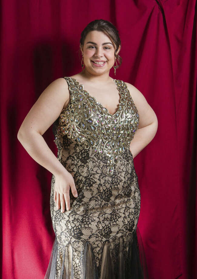 This undated image released by New York City Glitz shows Maria Giorno, 18, a high school senior from Manchester Township, N.J., models a prom dress at New York City Glitz boutique in Pine Beach, N.J. (AP Photo/New York City Glitz, Philip Shepherd)