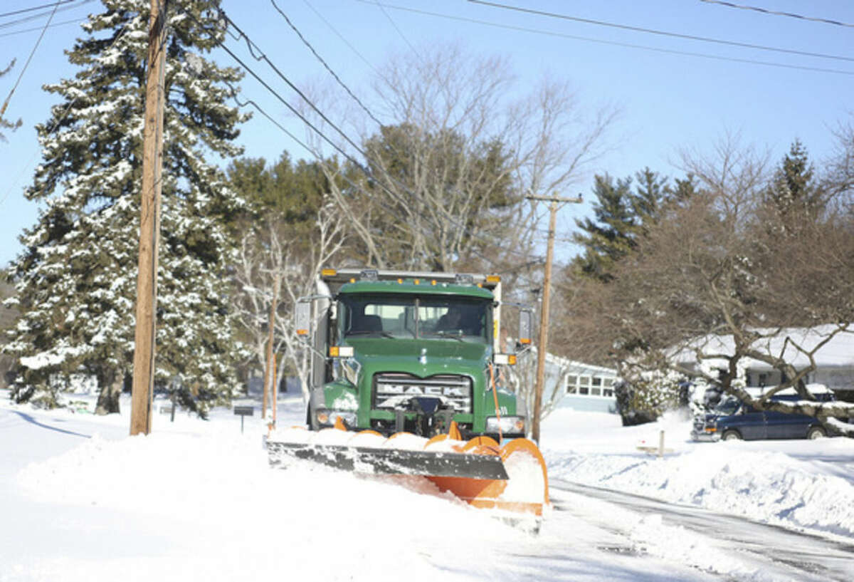 A city plow clears snow off of Pheasant Lane in Norwalk after Winter Storm Jonas Sunday morning. Hour Photo / Danielle Calloway