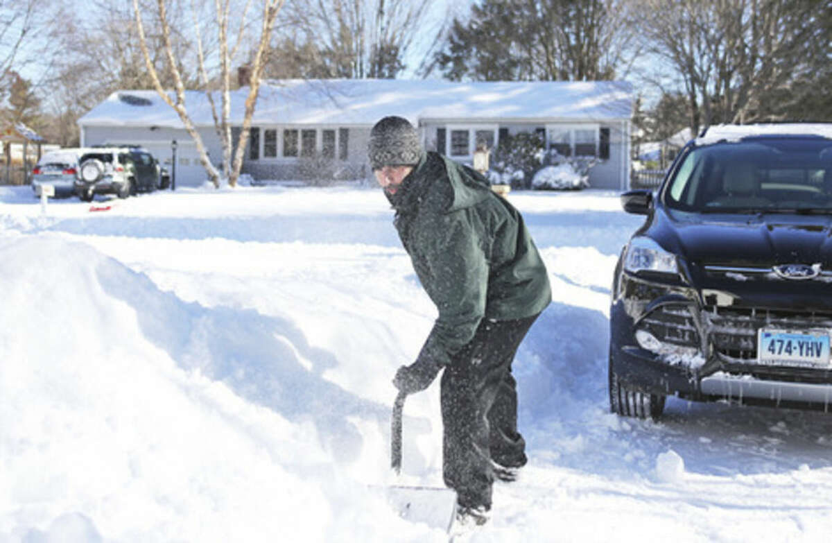 Andrew DellaCorte shovels his driveway in Norwalk after Winter Storm Jonas Sunday morning. Hour Photo / Danielle Calloway