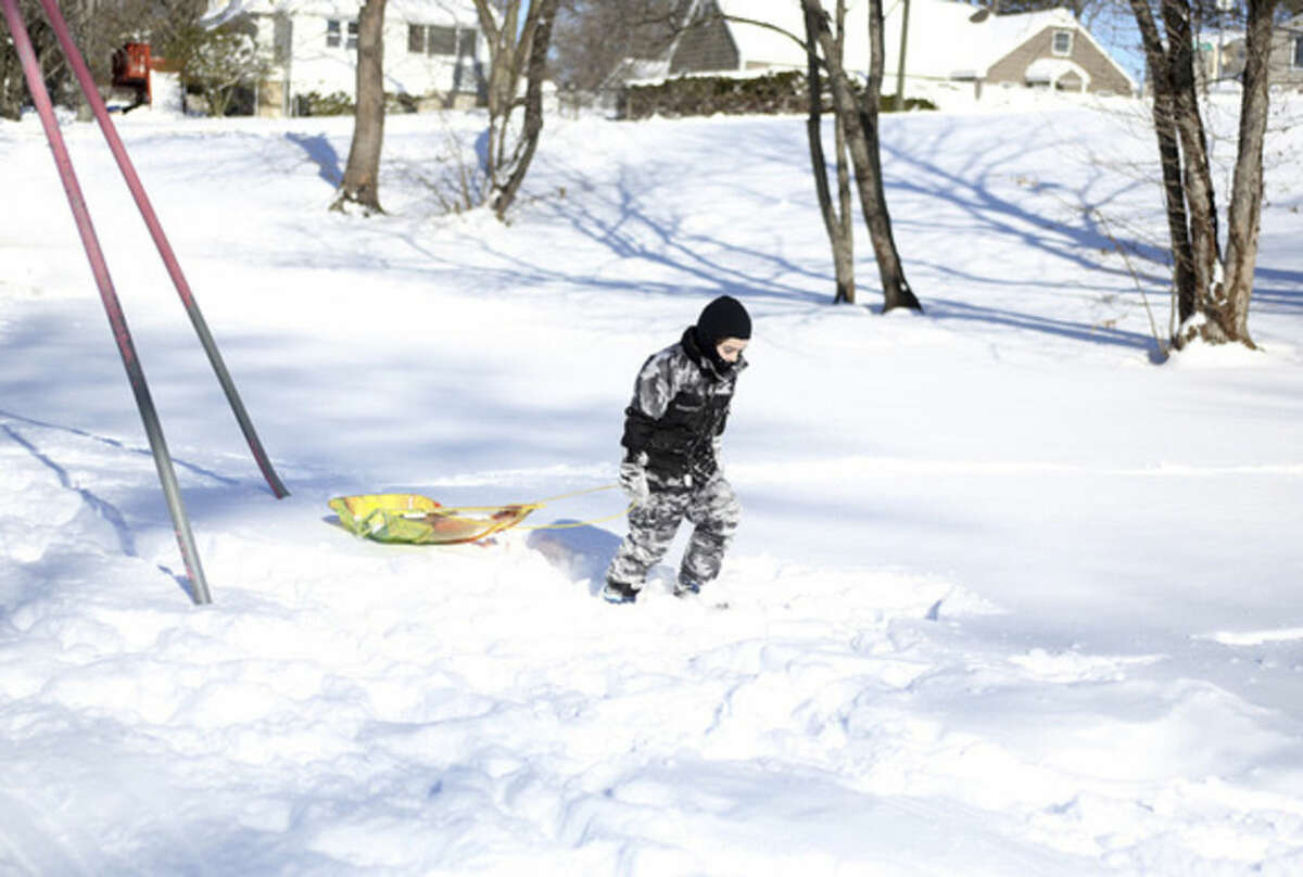 Gracyn James, 3, goes sledding at Kendall School after Winter Storm Jonas Sunday morning. Hour Photo / Danielle Calloway