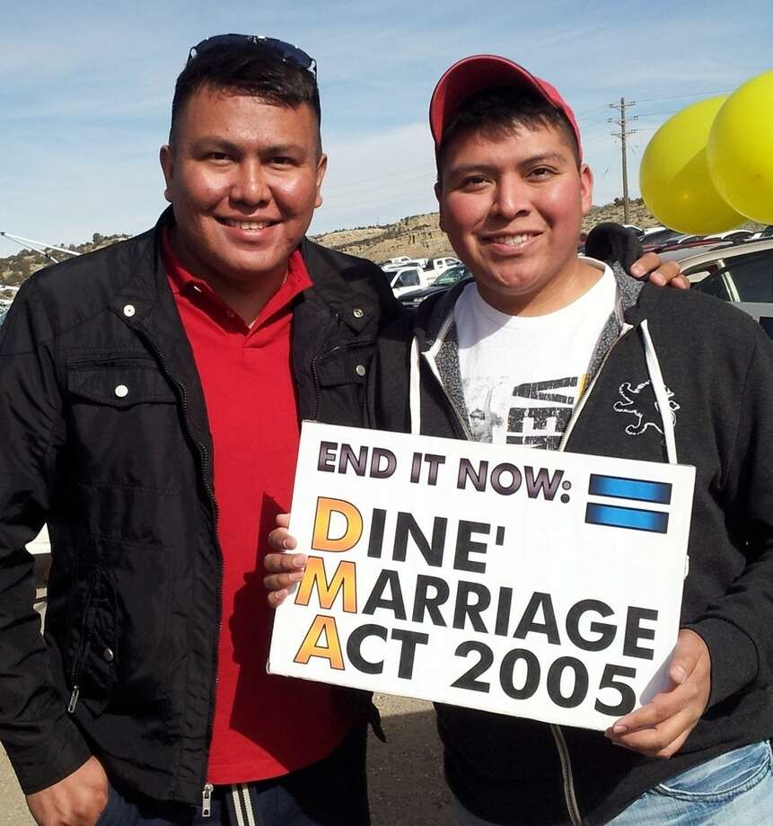 In this Jan. 25, 2014 photo provided by Jerry Archuleta, Alray Nelson, left, and Brennen Yonnie, right, pose for a photo at the flea market in Gallup, N.M. The couple has been advocating to have a Navajo Nation law that prohibits same-sex marriages repealed. (AP Photo/Jerry Archuleta)