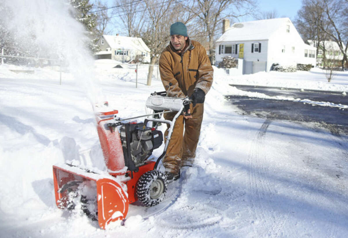 Hour Photo / Danielle Calloway Patrick Robinson uses his snow blower on Rockmeadow Road in Norwalk after Winter Storm Jonas Sunday morning.