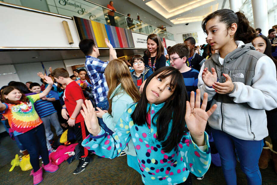 Hour photo / Erik Trautmann Roxbury Elementary School Stamford Education 4 Autism (SE4A) buddy Genna Diaz dances to the opening music as Stamford Education 4 Autism hosts a World Autism Awareness Day celebration at the Stamford Government Center Wednesday morning.