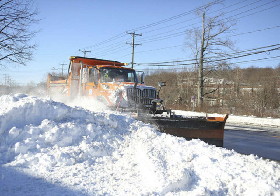 A CT State Plow clears snow off of Maine Avenue in Norwalk after Winter Storm Jonas Sunday morning.Hour Photo / Danielle Calloway
