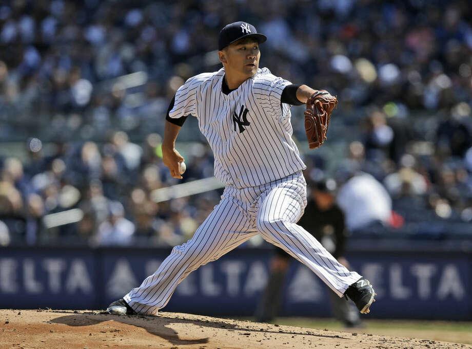 New York Yankees starting pitcher Masahiro Tanaka pitches during the third inning of the baseball game against the Toronto Blue Jays at Yankee Stadium, Monday, April 6, 2015 in New York. (AP Photo/Seth Wenig)