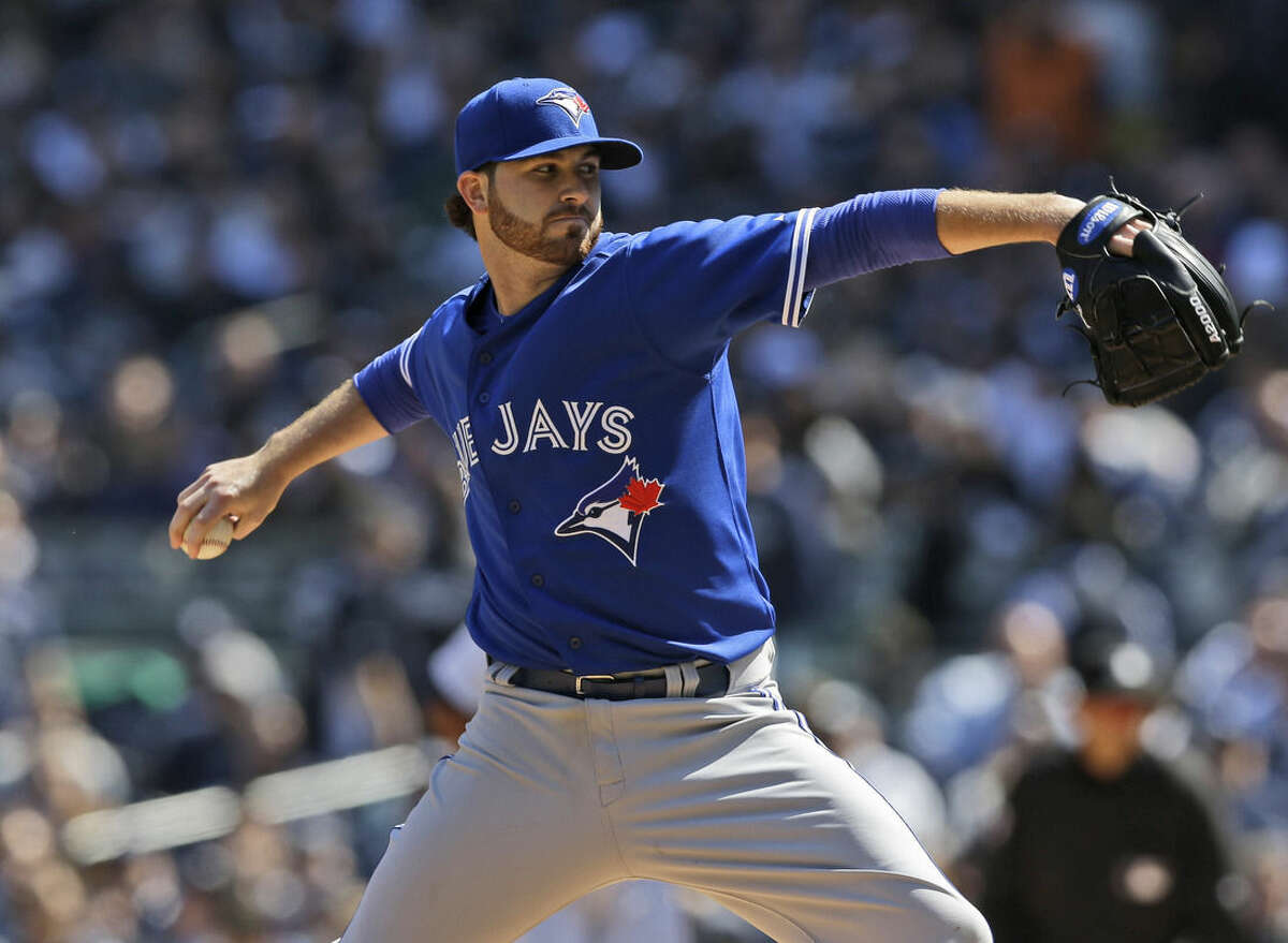 Toronto Blue Jays starting pitcher Drew Hutchison pitches during the third inning of the baseball game against the New York Yankees at Yankee Stadium, Monday, April 6, 2015 in New York. (AP Photo/Seth Wenig)