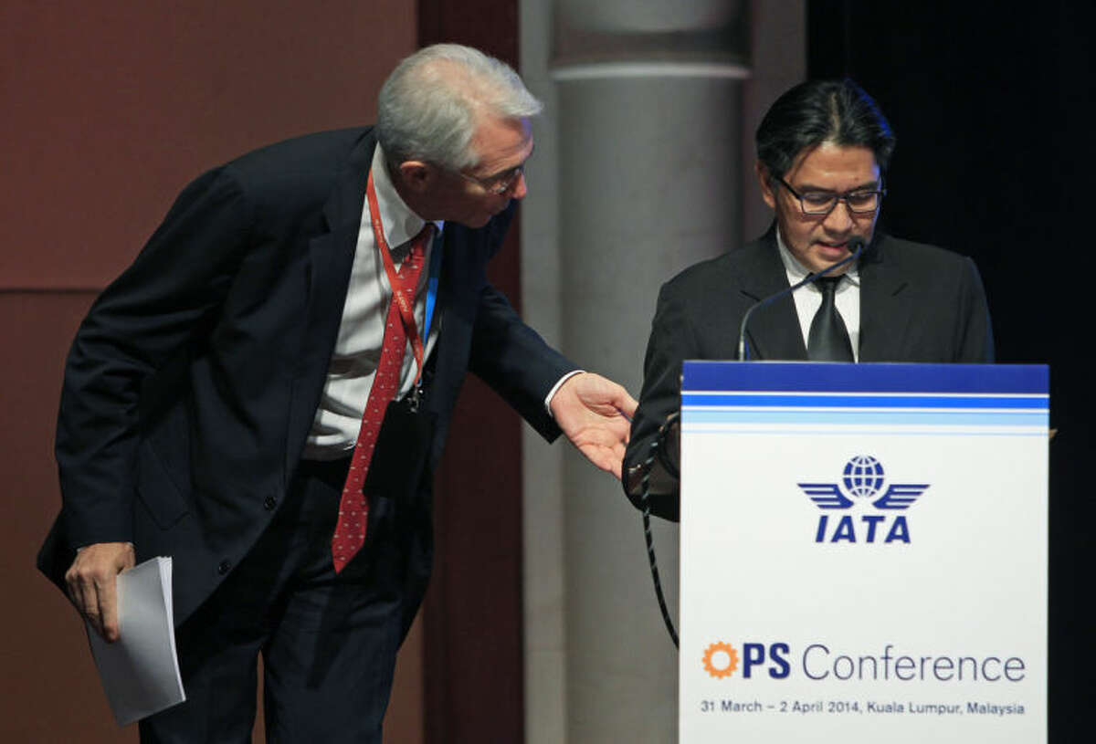 Chief Executive and Director General of the International Air Transport Association (IATA) Tony Tyler, left, talks to Malaysia's Department of Civil Aviation Director General Azharuddin Abdul Rahman after Azharuddin stopped his speech halfway and requested journalists to leave the conference room during the IATA Ops Conference in Kuala Lumpur, Malaysia, Tuesday, April 1, 2014. (AP Photo/Lai Seng Sin)