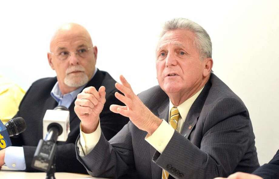 Hour Photo/Alex von Kleydorff. Mayor Harry Rilling announces the formation of the Norwalk Central Task Force on Wednesday at City Hall