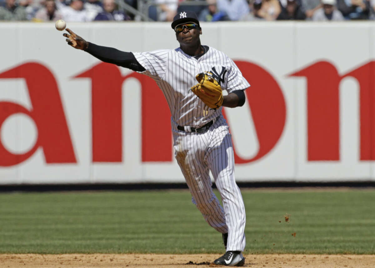 New York Yankees shortstop Didi Gregorius, replacing longtime Yankees shortstop Derek Jeter, who retired at the end of the 2014 season, throws to first in the fourth inning of an opening day baseball game against the Toronto Blue Jays in New York, Monday, April 6, 2015. (AP Photo/Kathy Willens)