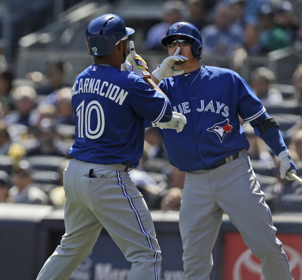 Toronto Blue Jays' Edwin Encarnacion, left, celebrates his home run with Josh Donaldson during the third inning of the baseball game against the New York Yankees at Yankee Stadium, Monday, April 6, 2015 in New York. (AP Photo/Seth Wenig)
