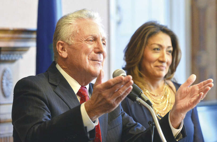Hour Photo/Alex von Kleydorff Norwalk Mayor Harry Rilling with wife Lucia by his side, thanks the city of Norwalk during a swearing in ceremony at City Hall on Tuesday.