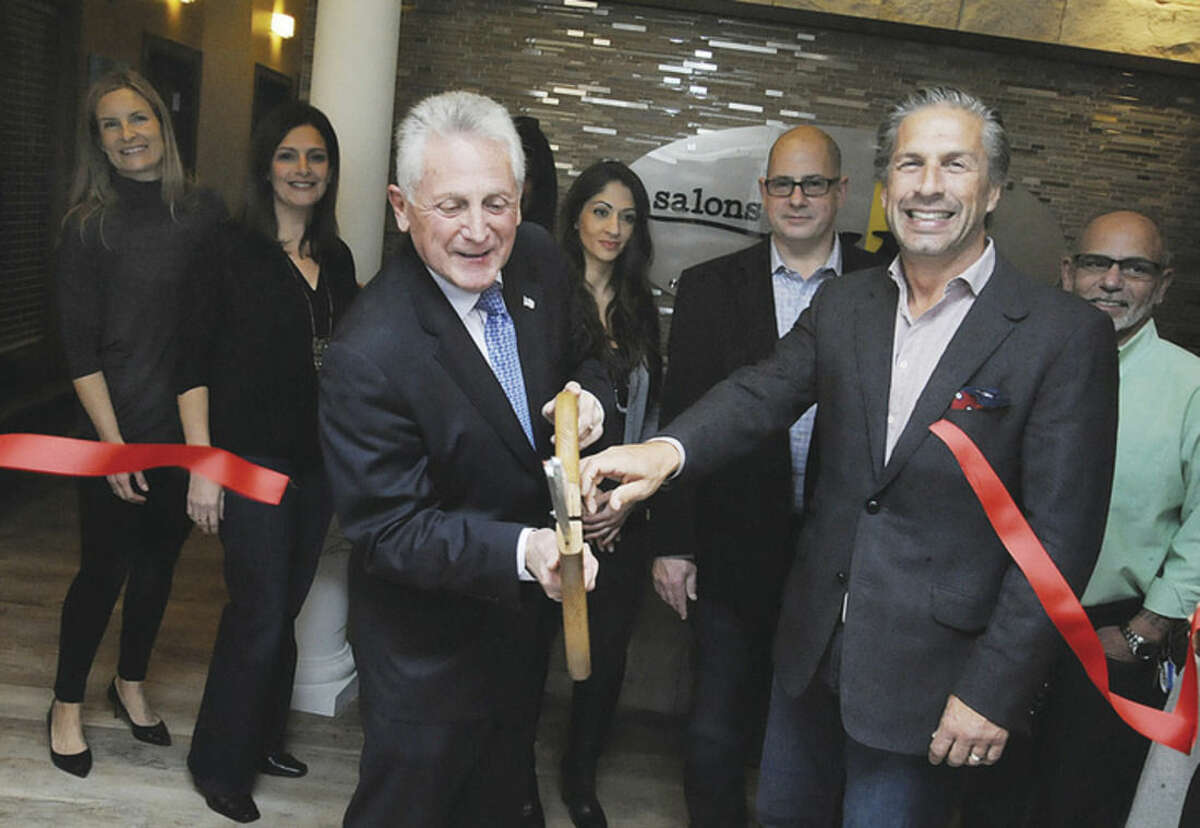 Salons by JC has their grand opening celebration at Waypointe in Norwalk Monday with Norwalk Mayor Harry and owner Derek Correia cutting the ribbon. Hour photo/Matthew Vinci