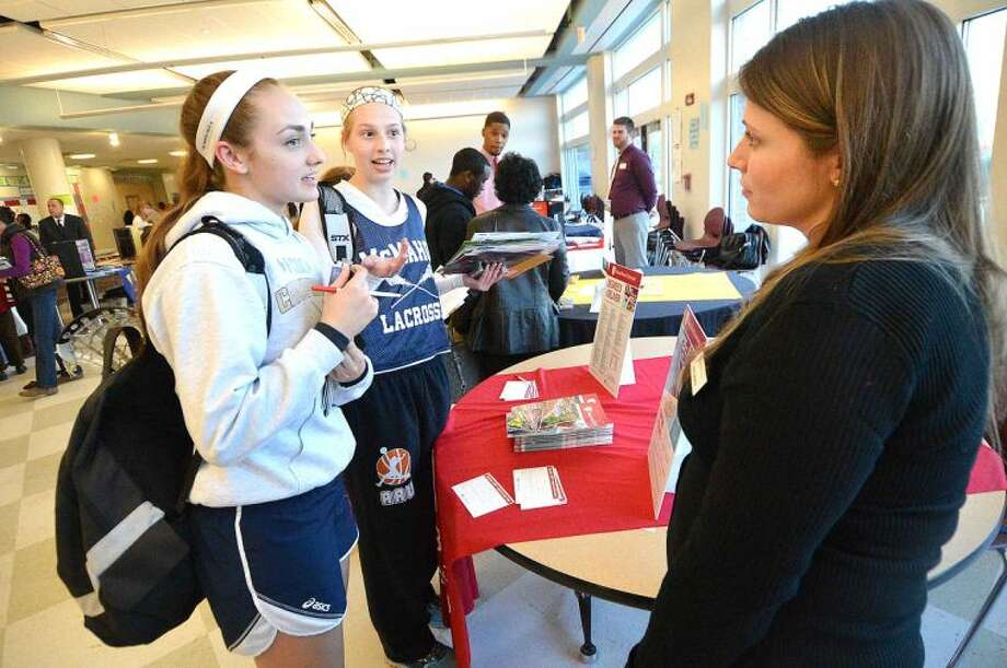 Hour Photo/Alex von Kleydorff Brien McMahon Juniors Rachael Kurtzman and Aleigh Fitzpatrick get some information about Stony Brook University durint the Citywide Collega Fair