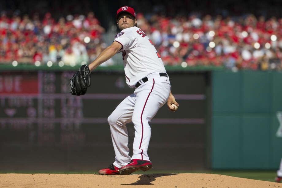 Washington Nationals starting pitcher Max Scherzer delivers a pitch against the New York Mets during the first inning of an opening day baseball game at Nationals Park on Monday, April 6, 2015, in Washington. (AP Photo/Evan Vucci)