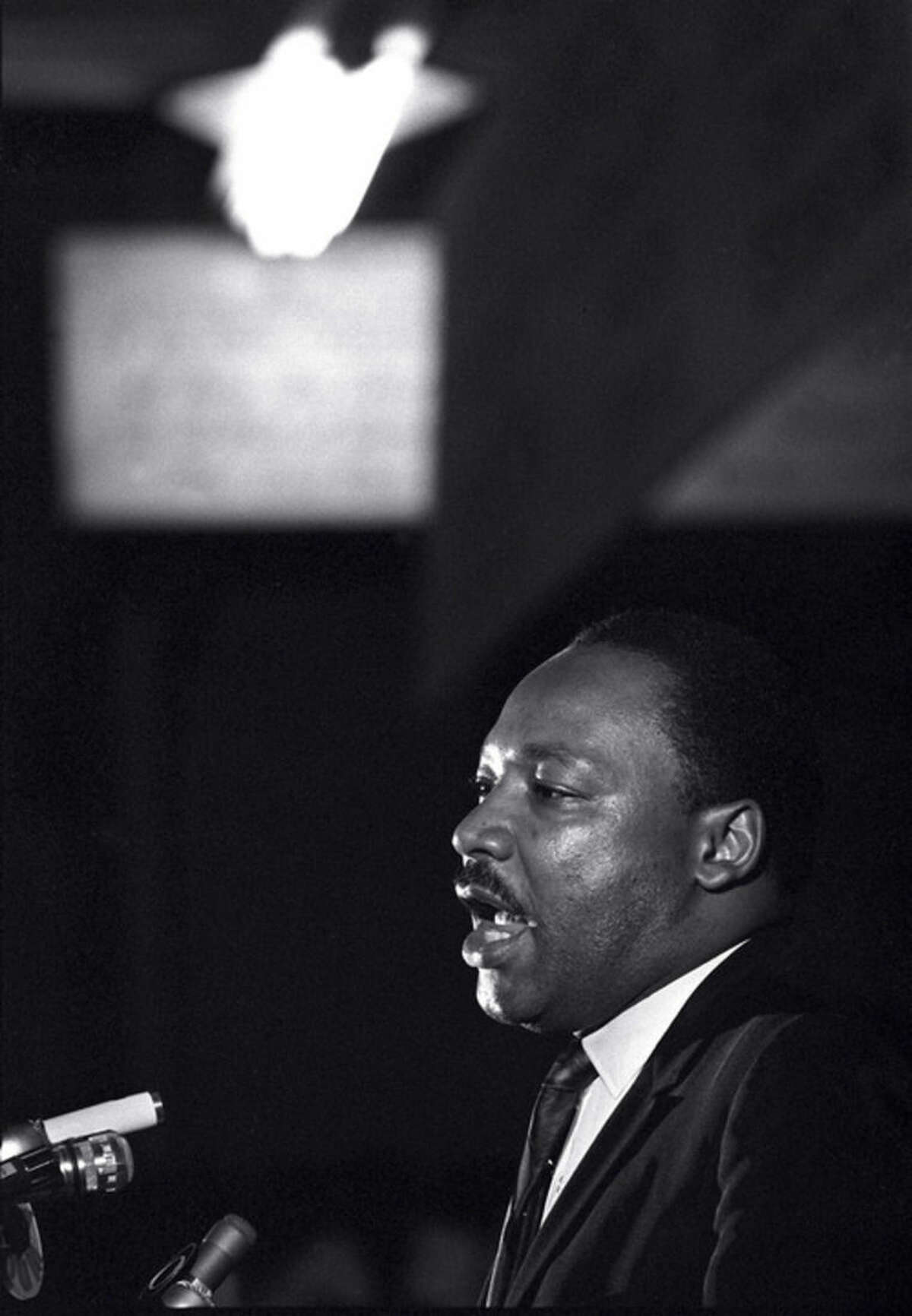 """ADVANCE FOR USE SUNDAY, JAN. 17, 2015 AND THEREAFTER - FILE - In this April 3, 1968 file photo, Dr. Martin Luther King Jr. makes his last public appearance at the Mason Temple in Memphis, Tenn. The following day King was assassinated on his motel balcony. In a new memoir, """"My Life with the Kings: A Reporter's Recollections of Martin, Coretta and the Civil Rights Movement,"""" retired Associated Press reporter Kathryn Johnson describes many civil rights flashpoints that she covered in the 1960s, and details her close relationship with the movement's leader, the Rev. Martin Luther King Jr., and his family. (AP Photo/Charles Kelly, File)"""