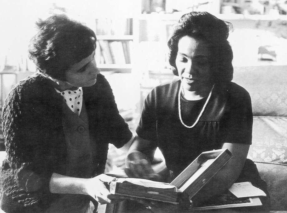 "ADVANCE FOR USE SUNDAY, JAN. 17, 2015 AND THEREAFTER - In this 1968 photo, Coretta Scott King and AP reporter Kathryn Johnson, left, review plans for The King Center during a meeting on the campus of Atlanta University in Atlanta. In a new memoir, ""My Life with the Kings: A Reporter's Recollections of Martin, Coretta and the Civil Rights Movement,"" retired Associated Press reporter Kathryn Johnson describes many civil rights flashpoints that she covered in the 1960s, and details her close relationship with the movement's leader, the Rev. Martin Luther King Jr., and his family. (AP Photo)"