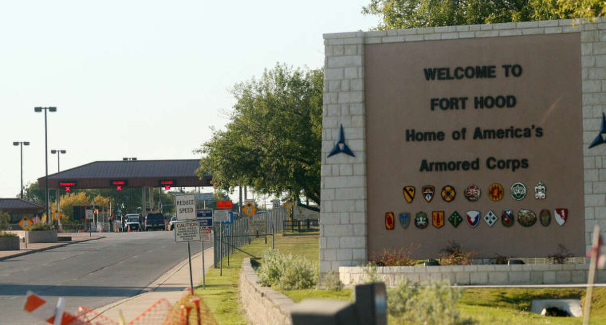 FILE - In this Thursday, Nov. 5, 2009, file photo, an entrance is shown to Fort Hood Army Base in Fort Hood, Texas. Fort Hood says there's been a shooting at the Texas Army base and that there have been injuries, on Wednesday, April 2, 2014. (AP Photo/Jack Plunkett)