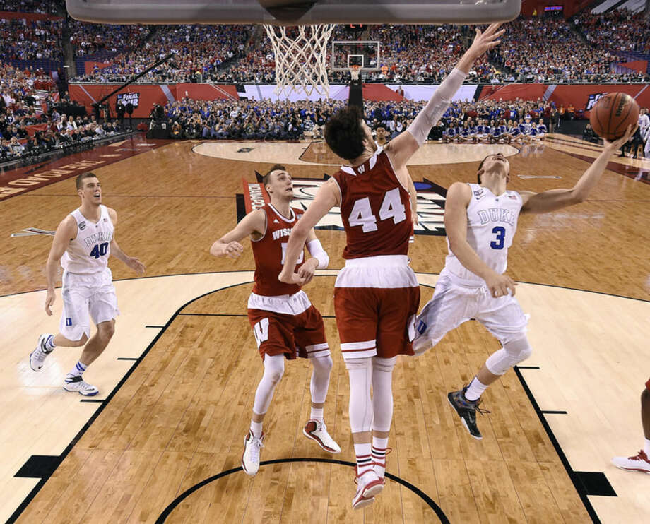 Wisconsin's Frank Kaminsky (44) tries to block a shot by Duke's Grayson Allen (3) during the first half of the NCAA Final Four college basketball tournament championship game Monday, April 6, 2015, in Indianapolis. (AP Photo/Chris Steppig, Pool)