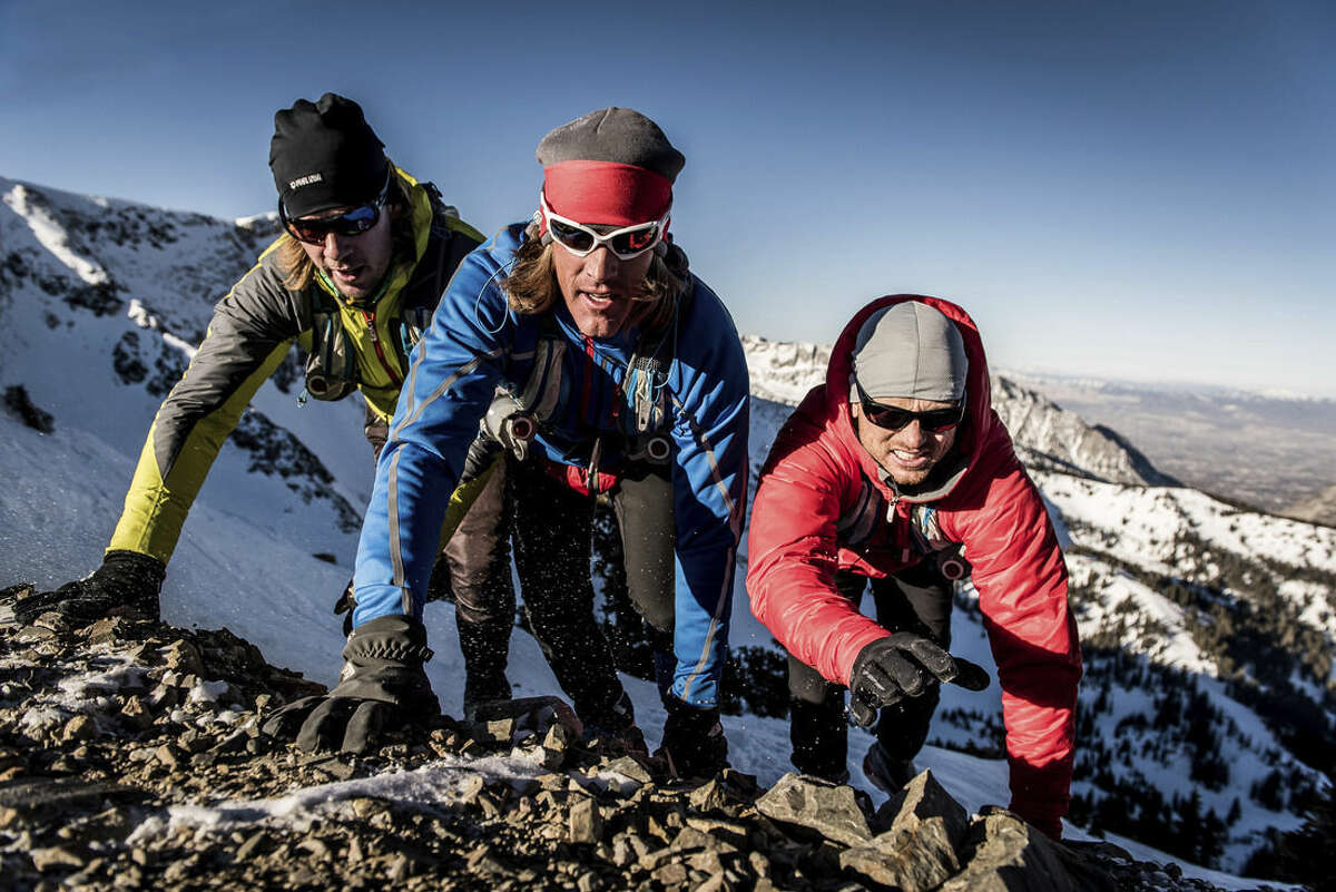 """In this image released by Animal Planet, from left, Matt Galland, Blake Josephson and Danny Bryson appear in a scene from """"100 Miles From Nowhere,"""" an extreme travelogue airing Sundays at 10 p.m. ET on Animal Planet. (AP Photo/Animal Planet, Matt Trappe)"""