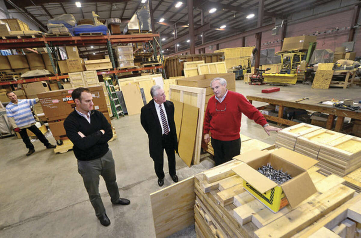 Hour photo/Erik Trautmann Norwalk Mayor Harry Rilling, center, meets with Jeff and Mickey Alexander, vice president and president of Commerce Packaging on Wilson Avenue on Wednesday, as part of the mayor's small business spotlight intiative.