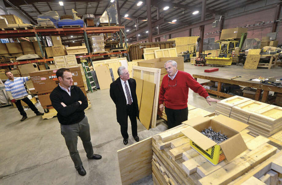 Hour photo/Erik TrautmannNorwalk Mayor Harry Rilling, center, meets with Jeff and Mickey Alexander, vice president and president of Commerce Packaging on Wilson Avenue on Wednesday, as part of the mayor's small business spotlight intiative.