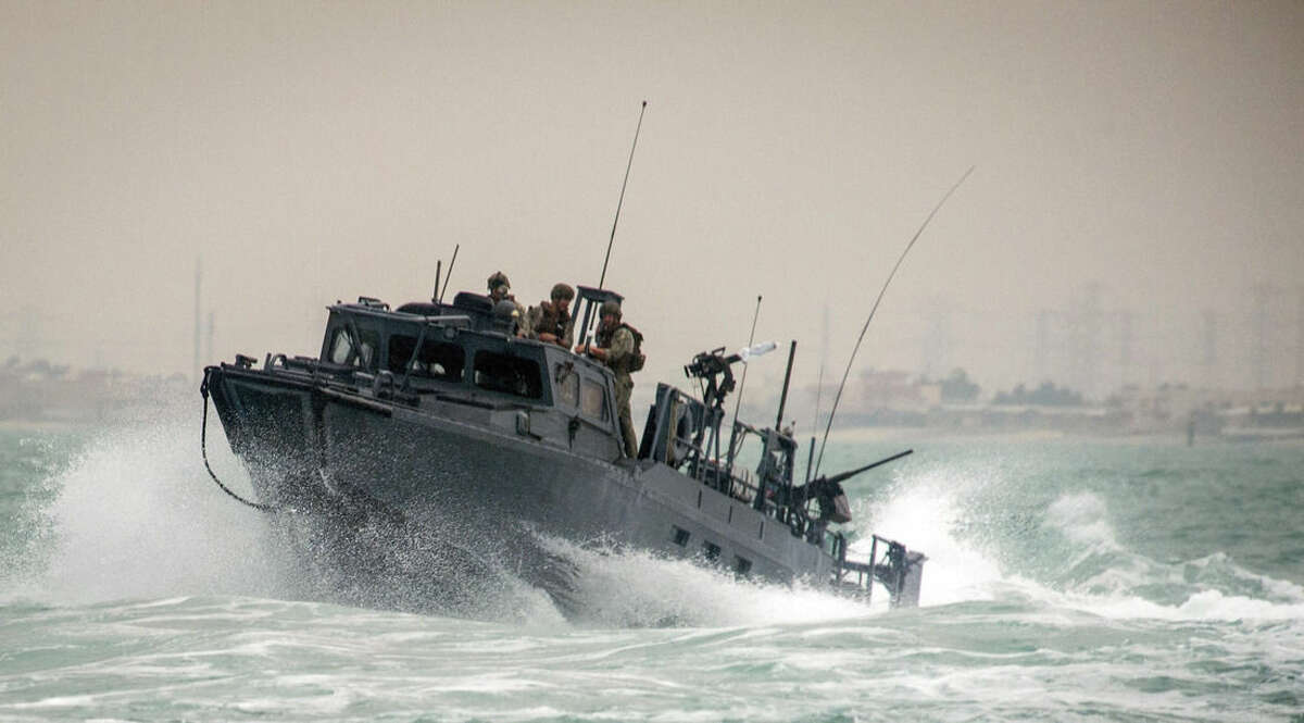 In this Oct. 30, 2015, photo provided by the U.S. Navy, Riverine Command Boat (RCB) 805, along with its crew members, is shown transiting through rough seas during patrol operations in the Persian Gulf. Iran was holding 10 U.S. Navy sailors and their two boats, similar to the one in this picture, on Jan. 12, 2016, after the boats had mechanical problems and drifted into Iranian waters. American officials have received assurances from Tehran that they will be returned safely and promptly. (Torrey W. Lee/U.S. Navy via AP)