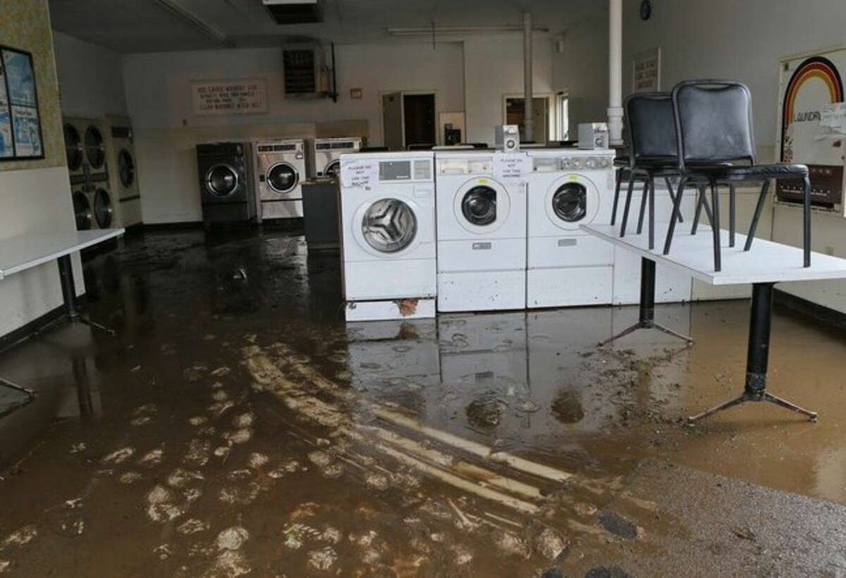 The Ballwin Laundromat had more than a foot of water in it after the storm on Tuesday in Ballwin, Mo., Wednesday,, April 8, 2015. The laundromat is located next to Fish Post Creek at Manchester Road near New Ballwin Road. (AP Photo/St. Louis Post-Dispatch, J.B. Forbes) EDWARDSVILLE INTELLIGENCER OUT, THE ALTON TELEGRAPH OUT