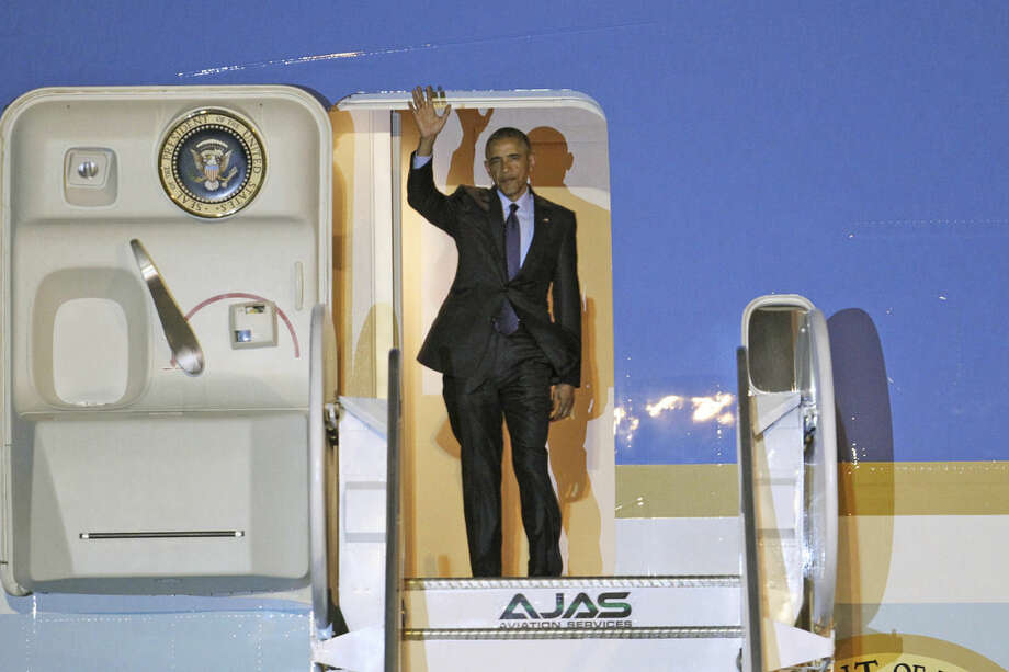 U.S. President Barack Obama waves during his arrival on Air Force One, Wednesday, April 8, 2015 at Norman Manley International Airport in Kingston, Jamaica. Obama arrived to Jamaica for a two day visit and will travel to Panama for the Summit of the Americas, April 10-11. (AP Photo/Ricardo Arduengo)