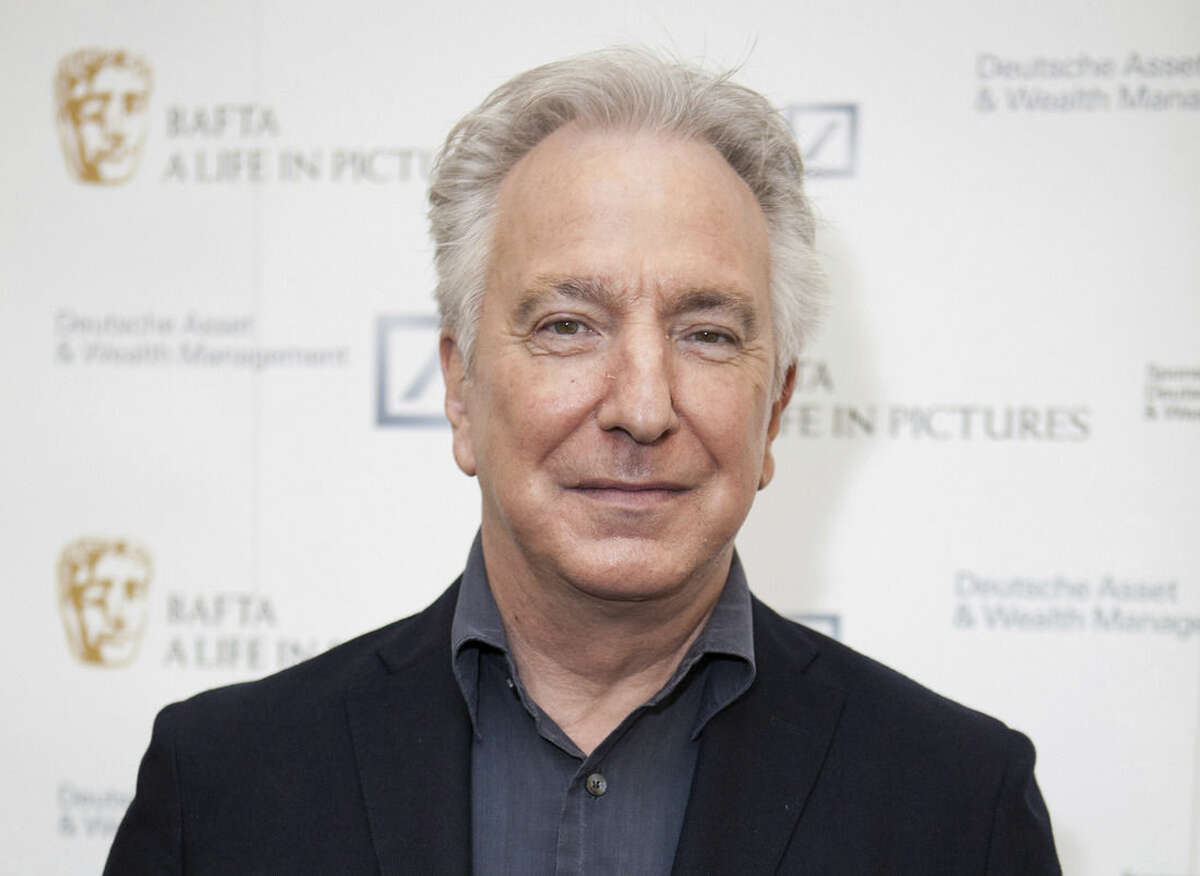 FILE - In this Wednesday, April 15, 2015 file photo, actor Alan Rickman poses for photographers on arrival at 'BAFTA A Life In Pictures, with Alan Rickman' in central London. British actor Alan Rickman, whose career ranged from Britain's Royal Shakespeare Company to the