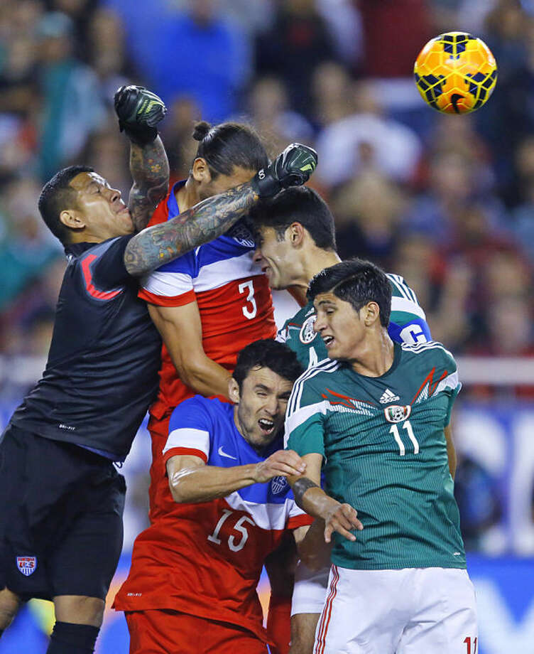 U.S. goalie Nick Rimando punches the ball to make a save against Mexico during an international friendly soccer match, Wednesday, April 2, 2014 in Glendale, Ariz. (AP Photo/The Arizona Republic, David Kadlubowski) MESA OUT MARICOPA COUNTY OUT MAGS OUT NO SALES