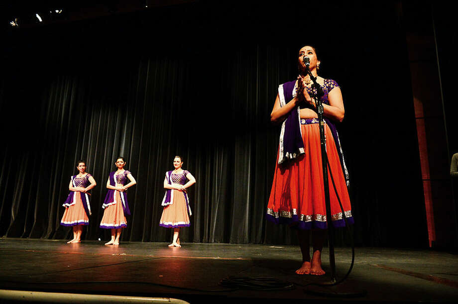 Hour photo / Erik Trautmann Wilton High School celebrates World Languages Week culminating with a performance from Ajna Dance, a traditional Indian dance troupe, Wednesday at the school.