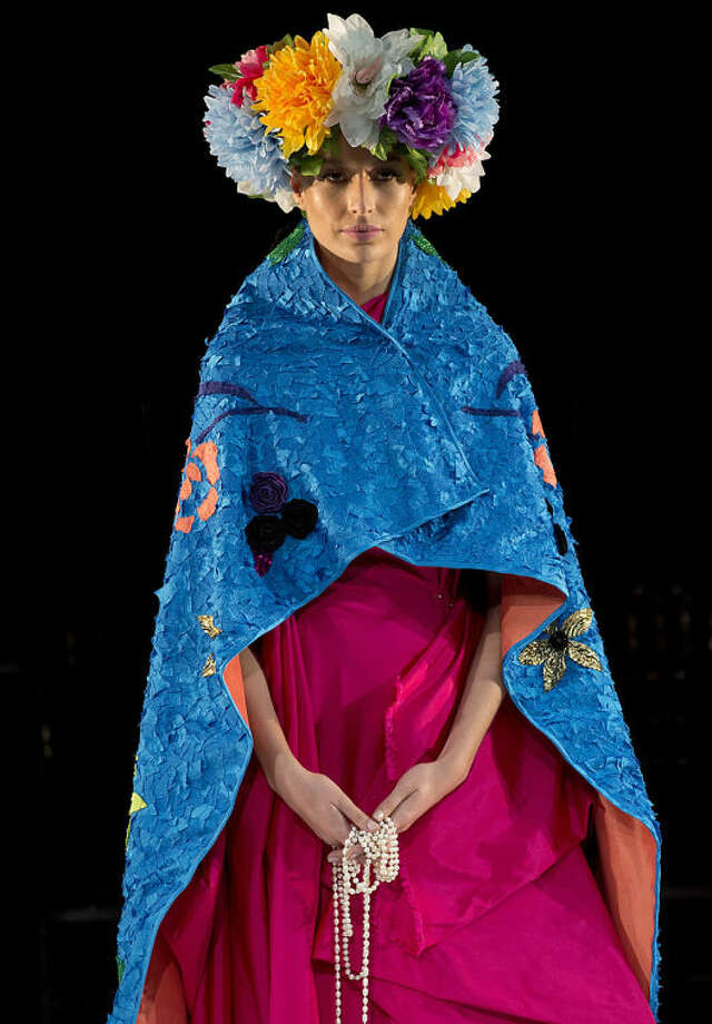 A model wears a creation from the Fause Haten Summer collection during Sao Paulo Fashion Week in Sao Paulo, Brazil, Wednesday, April 2, 2014. (AP Photo/Andre Penner)