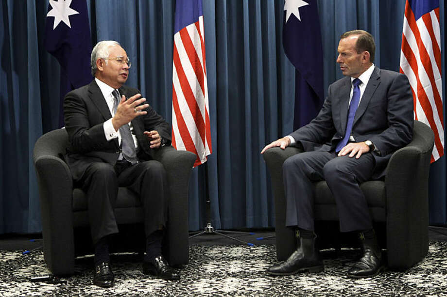 "Australian Prime Minister Tony Abbott, right, and Malaysian Prime Minister Najib Razak talk during their meeting at the Commonwealth Parliament Offices in Perth, Australia, Thursday, April 3, 2014. Abbott, whose country is coordinating the current search effort, spoke of ""very credible leads"" and ""increasing hope"" a day before Najib's announcement. But on Thursday he said the search has become ""the most difficult in human history."" (AP Photo/Richard Wainwright, Pool)"
